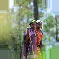Two women walking in village