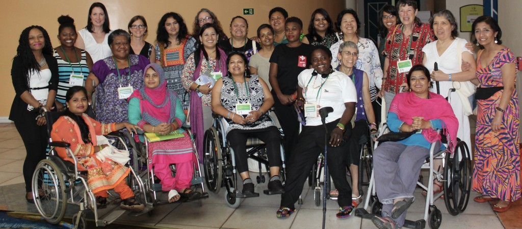 Group of women from around the world gather for a photo at AWID